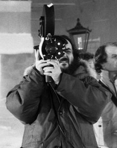 Director Stanley Kubrick operating camera on a shot on the Overlook Hotel's exterior set at MGM Elstree Studios.
