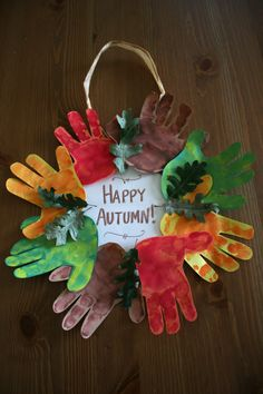 Autumn Handprint Wreath.  My eldest baby helped me make this for my Grandma and Papa back in Fall 2011.  He wasn't even two years old at the time. Memories... #autumn #handprintwreath #preschoolart