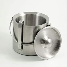 The ice bucket with lid features a handle for easy transport and matching ice tongs. Description from ebay.com. I searched for this on bing.com/images