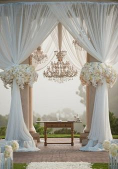 Glam Wedding Ceremony with Chandeliers and Gorgeous Flowers