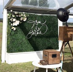 Photo Booth Backdrop We love this clever spin on the wedding photo booth. Have your guests post in front of a boxwood wall decorated with flowers and the newlyweds' names laser-cut from wood. Wedding Wall, Wedding Reception, Our Wedding, Dream Wedding, Flower Wall Wedding, Wedding Back Drop Ideas, Modern Wedding Ideas, Elegant Wedding, Wedding Venues