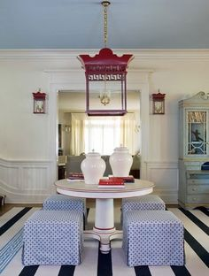 Decorating with Color: Red, White and Blue - Classic elements and a Chinoiserie inspired lantern offer a different twist on a red, white and blue color palette in a dining room.