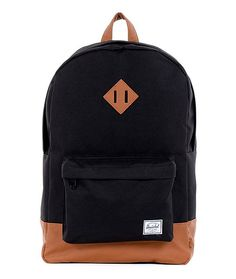 Old school class meets practicality and functionality. The Heritage backpack from Herschel Supply Co in the black colorway. It's a simple and organized backpack with nice padding for you and your gear. Plenty of main compartment storage and an easy access