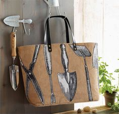Natural jute tote with vegan leather handles is printed with gardening…