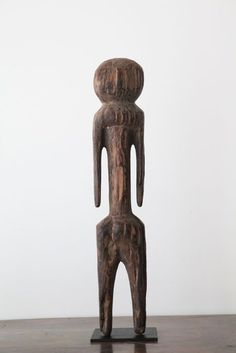 Moba  figures stand as sentinels in front of Togo homes and village entrances, and are also placed on intimate family altars, providing protection for those who