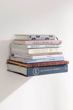 Hang invisible bookshelves for a super cool book display