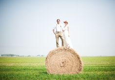 love this shot atop a bale of hay for this Canadian wedding