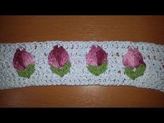 Botãozinho de flor embutida em tapete oval