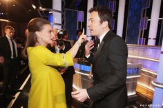 Natalie Portman helped Jimmy Fallon get something off his face.