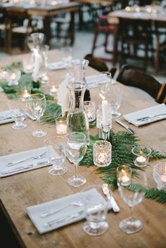 There's no need to spend a lot of money on flowers—an inexpensive but lush runner of ferns and greenery looks just as fresh. #MERRYBRIDES