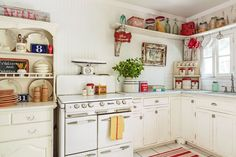 "This cottage came with a enameled O'Keefe & Merritt stove.The owner added the painted hutch and custom cabinets, just 16 inches deep to maximize floor space. An open shelf replaces upper cabinets, which would have ""suffocated"" the room. 1920s Kitchen, Mid Century Modern Kitchen, Vintage Kitchen, Home Decor Store, Home Decor Kitchen, Kitchen And Bath, Kitchen White, Cottage Kitchens, Home Kitchens"