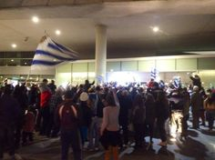 Hundreds of Uruguay fans wait at Montevideo Airport for the return of disgraced Luis Suarez. Remarkable.
