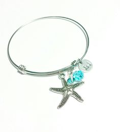 Items similar to Adjustable stainless steel bangle with Swarovski crystals and pewter starfish, Starfish bangle, Swarovski bangles, on Etsy Bangles, Bracelets, Starfish, Pewter, Turquoise Bracelet, Swarovski Crystals, Stainless Steel, Jewels, Trending Outfits