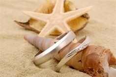 His and hers wedding rings in beach style wedding shoot
