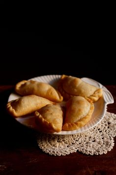karanji recipe - crisp flaky fried pastry stuffed with desiccated coconut and dry fruits. step by step recipe.