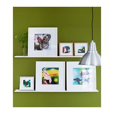 """For the back wall on the kitchen...dark brown accent wall, white frames with food pictures.   IKEA Ribba picture ledge, 45 1/4"""" long, $14.99."""