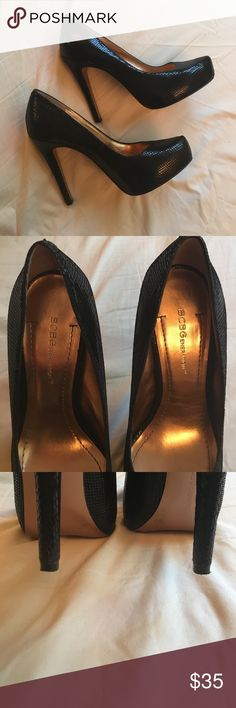 Gorgeous BCBG pumps. Black, faux snakeskin finish. Size 7, worn but in great condition. Heel height is 4.5 inches, with a .75 inch platform. No scuffs or blemishes, very slight wear on heels. Barely noticeable marks on the inner sole (pictured) Open to offers! BCBGeneration Shoes