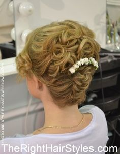 curly messy updo for medium hair