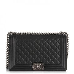 $4995 USA -This is an authentic CHANEL Caviar Quilted New Medium Boy Flap in Black. This stylish shoulder bag in the larger size is crafted of luxurious petite caviar leather in black framed by a linear quilting.