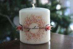 candle made with stamps and tissue paper