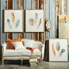 These gorgeous watercolor feather prints have the most beautiful color palette -- with peacock blues, sea greens, and rusty orange. We love their romantic feel!