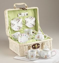 Children's tea set with party bear motif. Includes teapot, creamer and sugar, 2 plates, 2 cups and saucers, 2 forks and 2 spoons.  Made of porcelain and packaged in a lined basket for storage. Teapots hold 4 oz. and teacups 1-1/2oz.