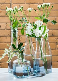 These impressive glass bottles feature an ombre detail. Whether filled with flowers, or used alone, these bottles have a look that is sleek and modern! @weddingwire