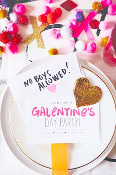 Finish setting up your Galentine's Day dinner party tablescape with a playful place setting.