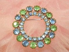 Vintage rhinestone wreath brooch pin. True vintage costume jewelry from the 1940's - 1950's era. Timeless classic design.
