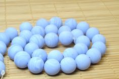 32 pcs of Blue lace agate matte round beads in 12mm