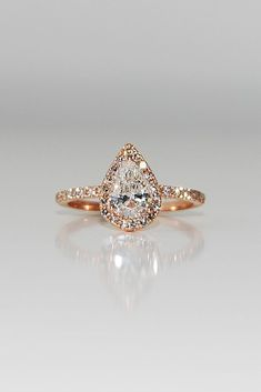 36 Utterly Gorgeous Engagement Ring Ideas ❤️ engagement ring inspiration halo pear cut rose gold pave band ❤️ See more: http://www.weddingforward.com/engagement-ring-inspiration/ #weddingforward #wedding #bride