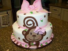 Monkey themed baby shower cake for a baby girl -