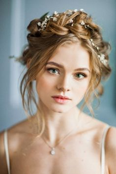 11 Effortlessly Romantic Wedding Hairstyles: This Dutch crown braid gets a modern twist with face framing pieces pulled loose and a vine of flowers intertwined. Photo by Antonova Kseniya; Hair by Nika Zaiceva 2015 Hairstyles, Crown Hairstyles, Formal Hairstyles, Bride Hairstyles, Romantic Wedding Hairstyles, Romantic Wedding Makeup, Flower Crown Hairstyle, My Hairstyle, Bridal Hair And Makeup