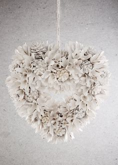 White heart shaped Christmas wreath with glitter and pine cones. Dimensions: 40cm x 40cm.