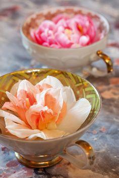 flowers floating in teacups