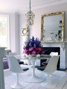 Saarinen Oval Dining Table by Eero Saarinen Saarinen Tulip Armless Chair