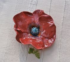 Red poppy flower. Handbuilt with earthenware fired clay. I drew the template on card which I then cut up and used to trace the petals on a