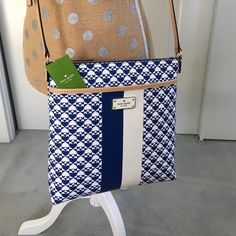 Kate Spade cross body! NEW FOR SPRING! Beautiful navy and white design with light camel colored strap! Brand new and so perfect for a new spring bag! kate spade Bags Crossbody Bags