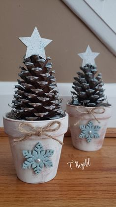 White washed terra cotta pots filled with a pinecone that has been lighty lightly sprayed in Rust-Oleum blue serenity. Dollar tree snowflake and star diy stickers were added as accents. They too were sprayed in paint. Jute twine bow for a finishing touch. Homemade Christmas Gifts, Christmas Crafts For Kids, Christmas Projects, Christmas Fun, Holiday Crafts, Christmas Decorations, Christmas Ornaments, Holiday Decor, Potted Christmas Trees