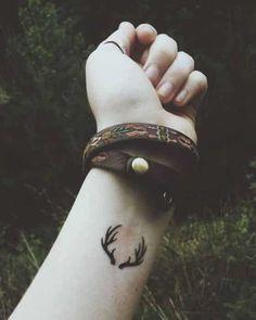 cuernos tatuaje