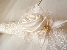 Wedding dress padded satin hanger with vintage lace, ivory and white. $40.00, via Etsy.