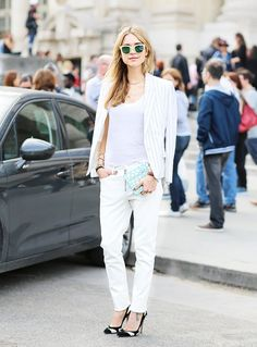 Pernille Teisbaek wears a white tank, white jeans, a striped blazer, and black and white pumps