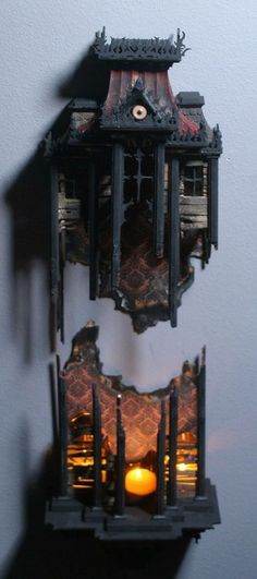 Crazy Haunted House Candle Holder Art Piece - so cool.  No idea where to get it