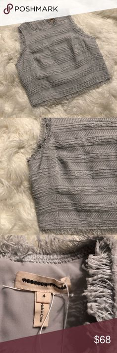 REBECCA TAYLOR frayed edge top. Size 4. Frayed edge top by Rebecca Taylor. Sleevless style. Features a zip up back. Slate grey color. Dry clean only. Originally $290. New without original tags. No flaws or defects and kept hung. Rebecca Taylor Tops