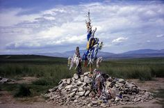photo of Siberia, Tuva, Tuvan Siberian shamanism and paganism, fields around Kyzyl, Sacred Ovaa (shamanic altar) made of stones, dry branches and cloth where Tuvans perform religious shaman offerings and sacrifices for the spirits