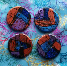 Unusual large round funky handmade buttons  by ButtonsByMcAnaraks.  i love her buttons, i'm busy using up my last order from her.