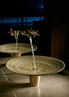 Inspired by ancient Southeast Asian tribal rain drums, the Kamala vessel-style bathroom sink is covered with an elaborate low-relief pattern of dots, ridges, scrolls, and links.