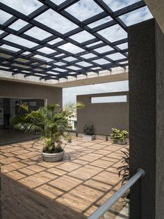 Image 22 of 23 from gallery of Hambarde Residence / Axis Design Studio. Photograph by Hemant Patil Rooftop Terrace Design, Terrace Garden Design, Rooftop Gardens, Villa Design, Roof Design, House Design, Landscape Structure, Landscape Architecture, Balcony Planters