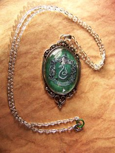 Slytherin House Crest Necklace /  THERE IS NO LIMIT TO HOW MUCH I WANT THIS