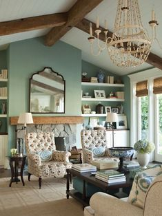 Vaulted and beamed ceilings. Swoon. Plus check out that fireplace and those built-in shelves!